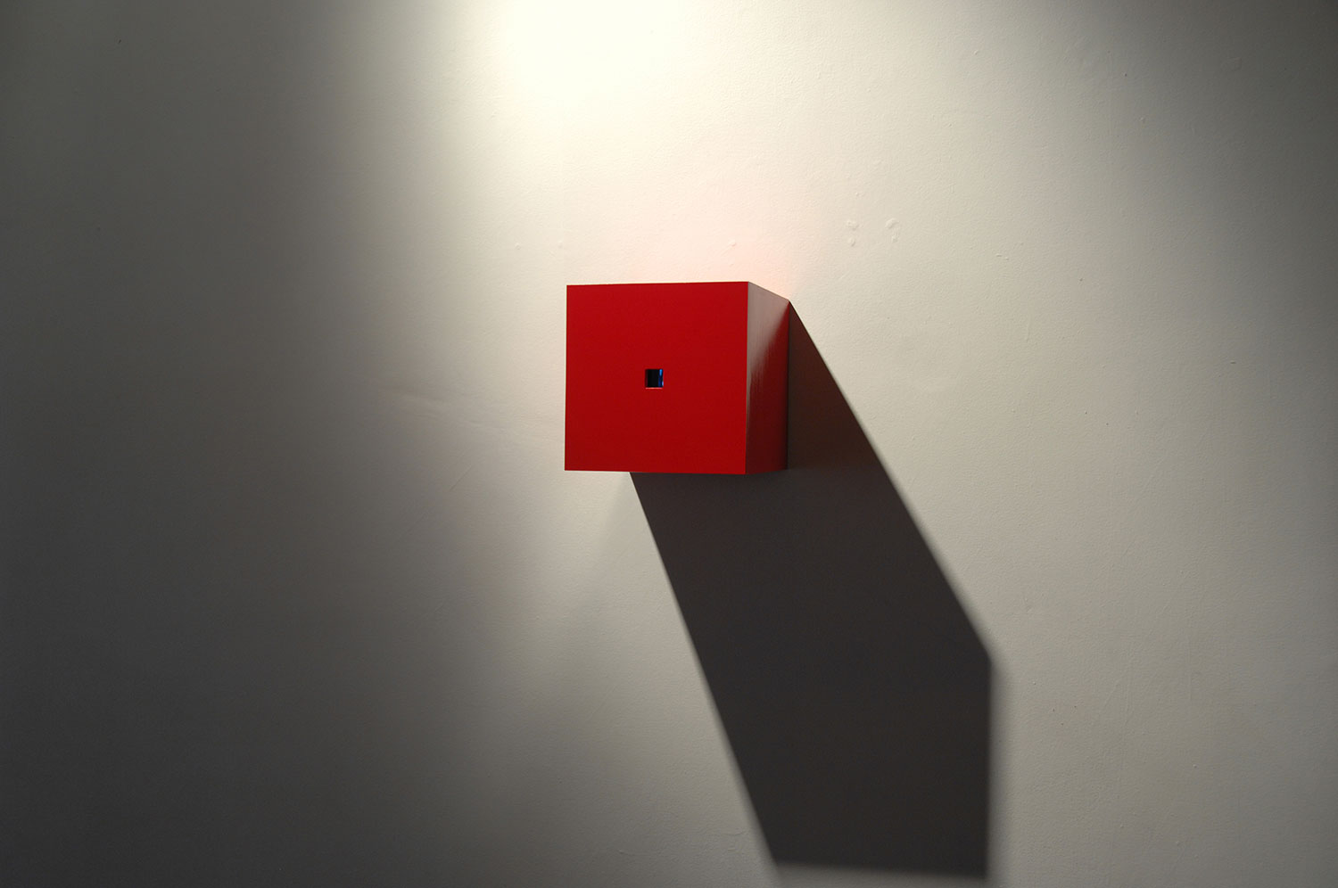 Existential Dilemma, 2003, video installation, two-channel, red box 11 x 11 x 11.5<br><br>Go to menu, click VIDEOS, to watch excerpts<br><br>Peek inside the box to find us continuously flipping inside a box that imposes laws of constraint.