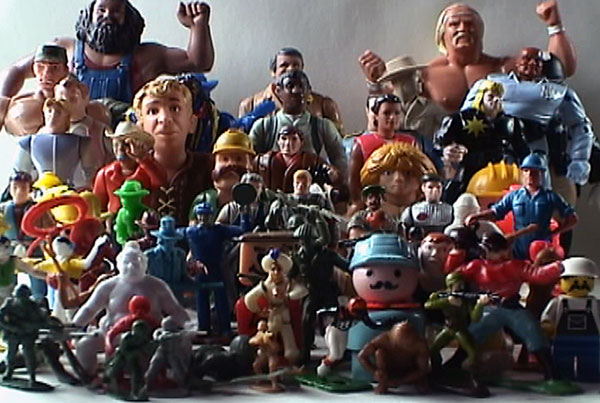 Man in Relation to Men, 2006, video still<br><br>Go to menu, click VIDEOS, to watch excerpts<br><br>Man in Relation to Men looks at masculinity using an array of male action figures from diverse eras.